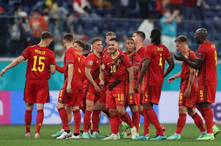 जीत के बाद जश्न मनाती बेल्जियम की टीम।