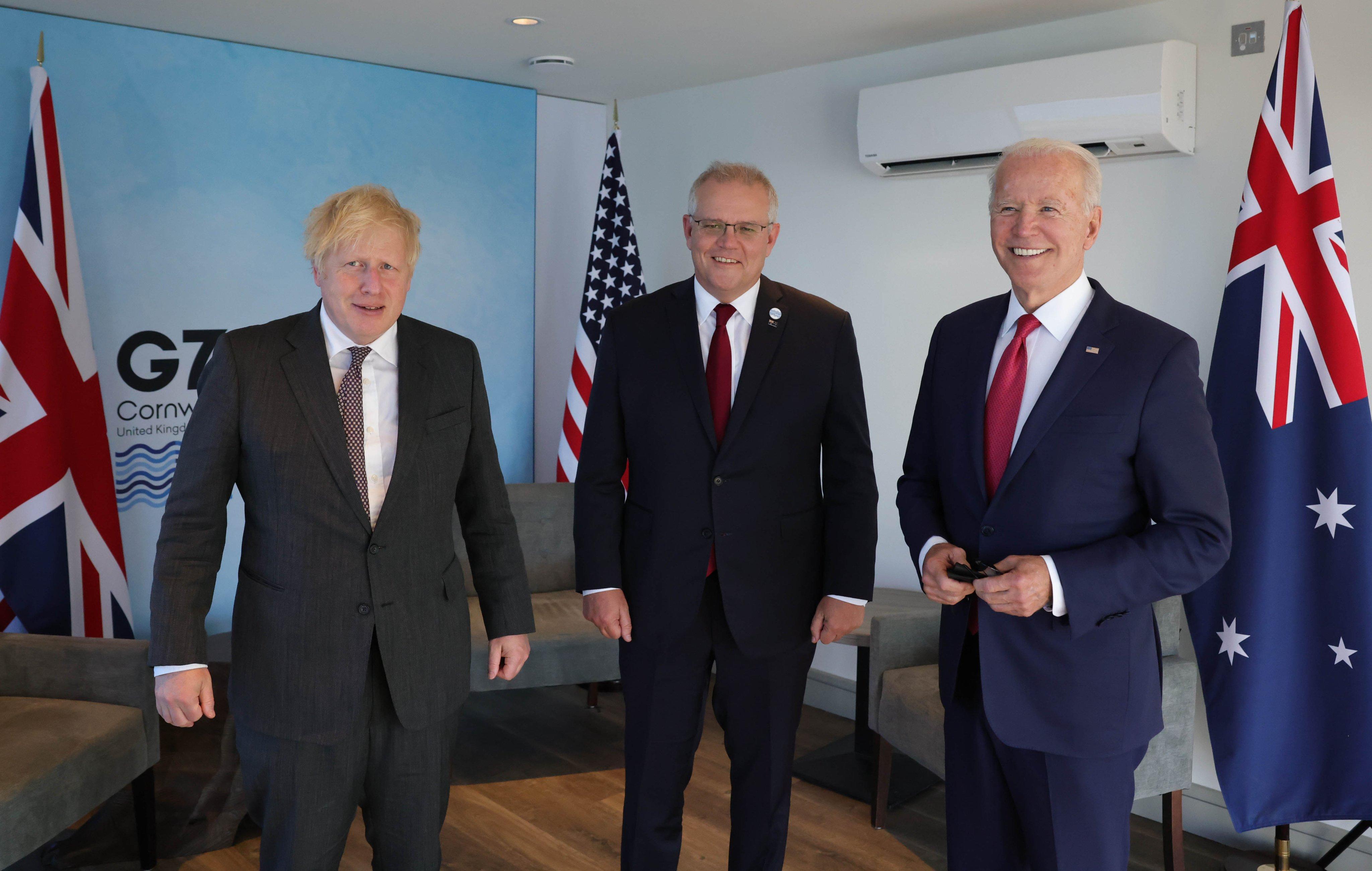 ब्रिटेन के पीएम बोरिस जॉनसन, ऑस्ट्रेलिया के पीएम स्कॉट मॉरिसन और अमेरिकी राष्ट्रपति जो बाइडेन।