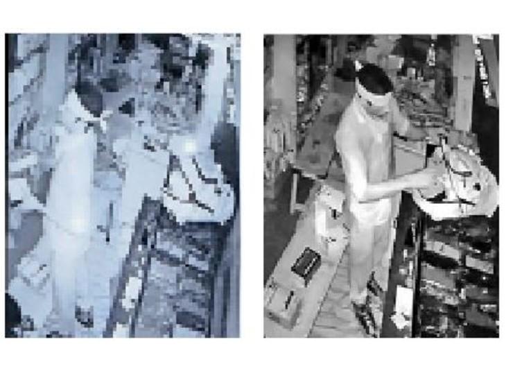 मुकुंदगढ़. शॉप से मोबाइल चुराकर बैग में डालता संदिग्ध। - Dainik Bhaskar