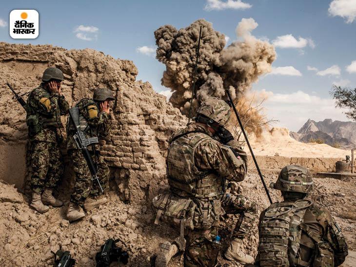 फरवरी 2013: अफगान (बाईं ओर) और अमेरिकी सैनिकों ने कंधार प्रांत के लायदिरा गांव में गोलीबारी के बीच तालिबान की एक चौकी को उड़ा दिया। फोटो: ब्रायन डेंटन