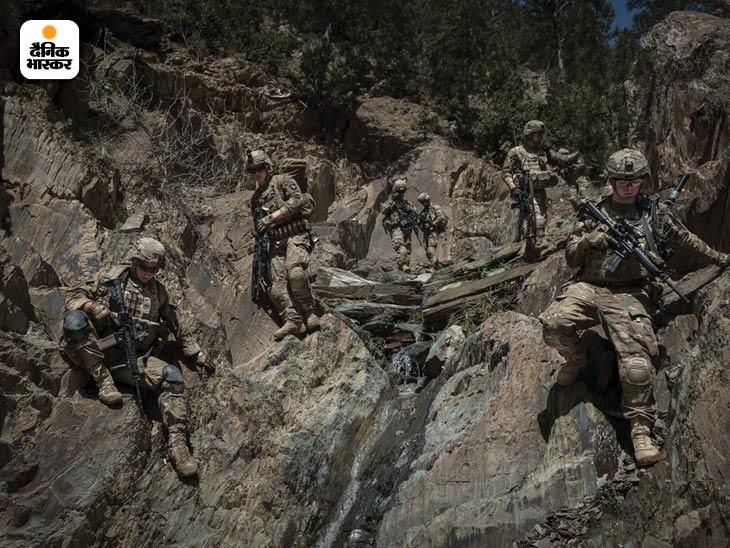 अप्रैल 2013: अफगानिस्तान के पक्तिया प्रांत में गश्त करता अमेरिकी सेना की 101वीं एयरबोर्न डिविजन के सैनिकों का दस्ता। फोटो: सर्गेई पोनोमारेव