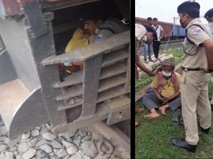 ट्रेन इंजन के नीचे पटरी में फंसे व्यक्ति को निकालते RPF जवान। - Dainik Bhaskar