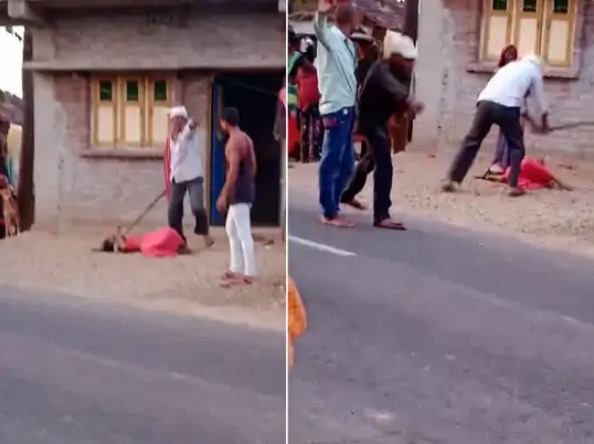 The accused family beat the woman so much on the middle of the road that she fainted.