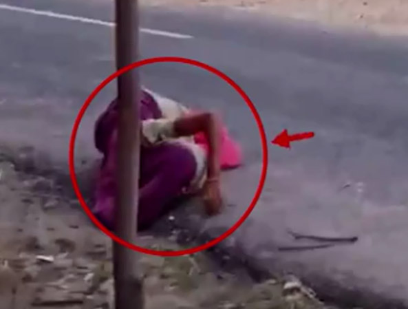 When the woman became breathless after being beaten up with sticks, the family members threw her on the roadside.