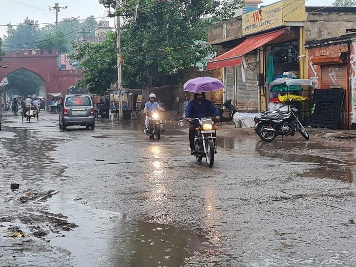 People walking towards their destination during the rain in Rewari on Saturday morning.