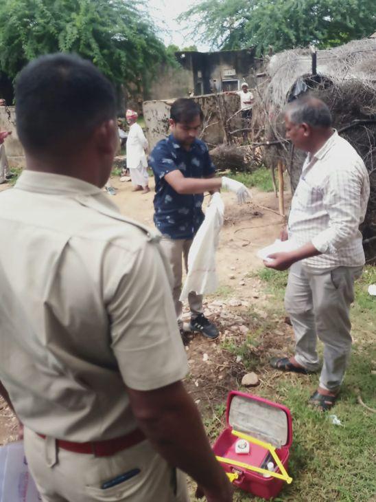 मौके पर जांच करती पुलिस