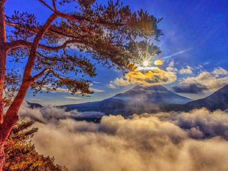 हल्की धूप में छाए बादल। - Dainik Bhaskar