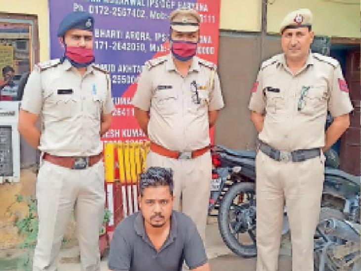 पुलिस गिरफ्त में आरोपी सूरज। - Dainik Bhaskar