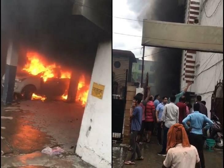 गाजियाबाद के सिहानी गेट क्षेत्र में कॉम्प्लेक्स के बेसमेंट में खड़ी कार में आग लग गई। इस दौरान काफी भीड़ इकट्ठा हो गई। - Dainik Bhaskar