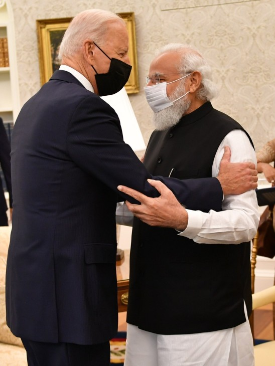 Biden greeted Modi with outstretched arms and thanked him for coming to America.