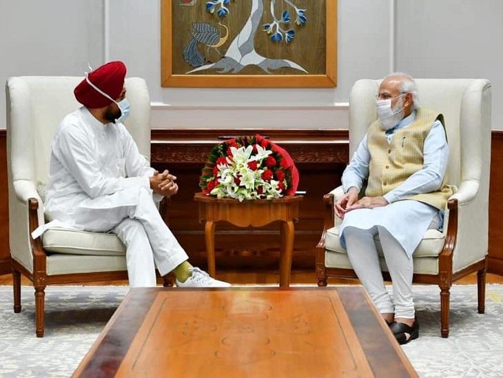 PM नरेंद्र मोदी से बातचीत करते CM चरणजीत चन्नी।