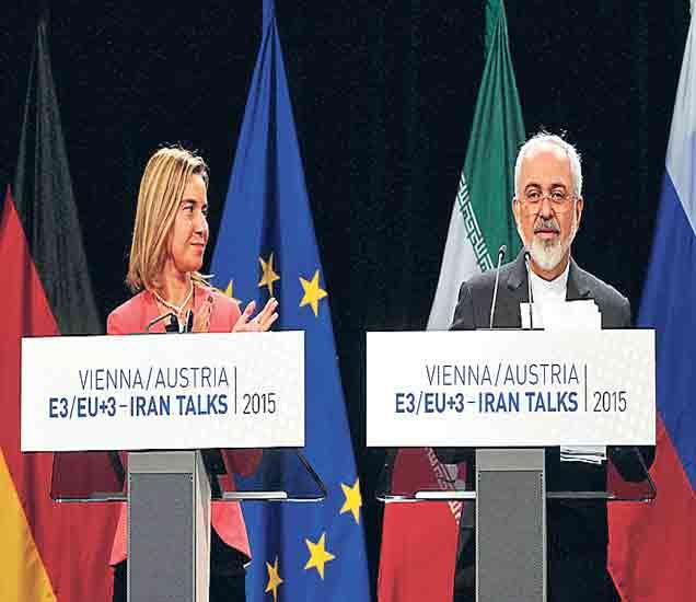 युरोपियन युनियनचे मोघेरिनी आणि इराणचे परराष्ट्रमंत्री मो. जवाद झरिफ. - Divya Marathi