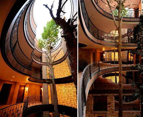 चित्र-विचित्र आहेत या इमारती, काही रेल्वे ट्रॅकवर तर काही उभ्या राहिल्या झाडांभोवती| - Divya Marathi
