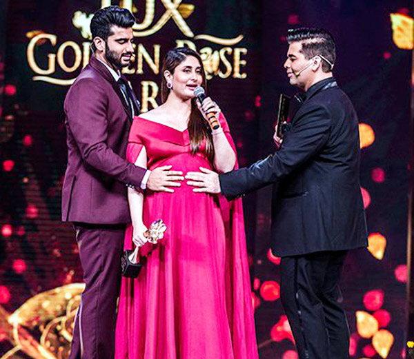 लक्स गोल्डन रोझ अवॉर्डदरम्यान करिनाच्या बेबी बंपला स्पर्श करताना करण-अर्जुन. - Divya Marathi