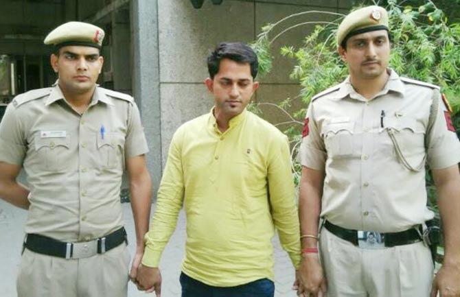 पोलिसांनी या टोळीचा मास्टरमाइंड पूरण गुप्ता याला अटक केली - Divya Marathi