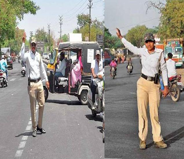शहरातील बहुतेक चौकांमध्ये वाहतूक पोलिसांना उन्हात उभे राहून वाहतूक नियमन करावे लागते. - Divya Marathi