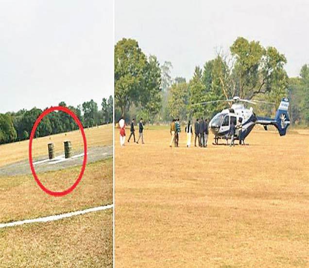 डेहराडूनच्या जीटीसी हेलिपॅडवर ठेवलेले दाेन ड्रम (लाल वर्तुळात). त्यामुळे हेलिपॅडवरच दुसऱ्या जागी उतरलेले मुख्यमंत्री रावत यांचे हेलिकाॅप्टर. - Divya Marathi