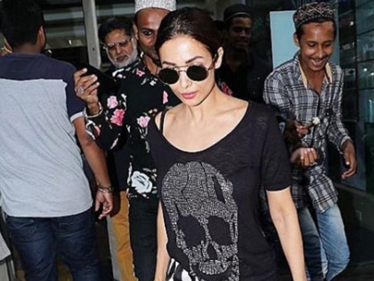Viral : मॉलमध्ये फॅन्सच्या गर्दीने सेल्फीसाठी मलायकाला घेरले, कशीतरी स्वतःला वाचवत पडली बाहेर| - Divya Marathi