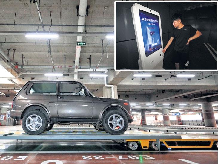 चीनमध्ये पहिली रोबोटिक पार्किंग ; बीजिंग विमानतळावर ८ रोबोटद्वारे केवळ एका मिनिटात होणार कारची पार्किंग|देश,National - Divya Marathi
