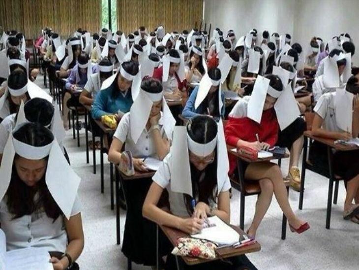 शिक्षकाने परीक्षेत विद्यार्थ्यांना कॉपी करण्यापासून रोखण्यासाठी त्यांच्या डोक्यावर ठेवले बॉक्स  - Divya Marathi
