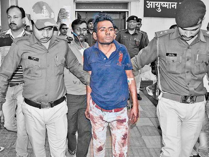 रक्ताने माखलेला आरोपी - Divya Marathi