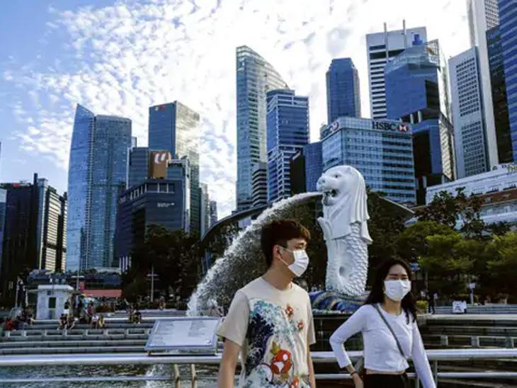 सिंगापूरमधून एक लाखाहून जास्त परदेशी व्यावसायिकांचे काेराेनाच्या कडक नियमांमुळे पलायन, लसीकरणात घट|विदेश,International - Divya Marathi