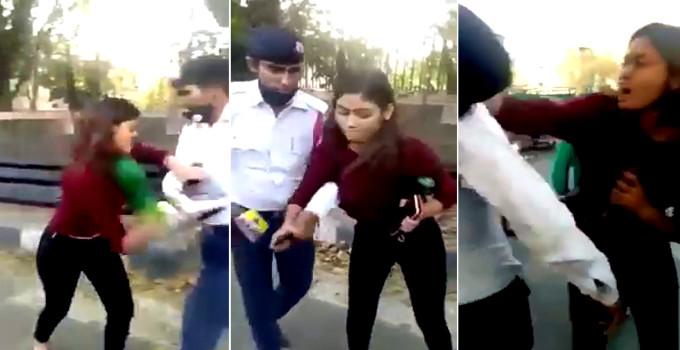 હેલમેટ વગર ડ્રાઈવ કરતા કપલને પકડ્યું ટ્રાફિક પોલીસે, ભડકેલી યુવતીએ કરી હાથાપાઈ  - Divya Bhaskar
