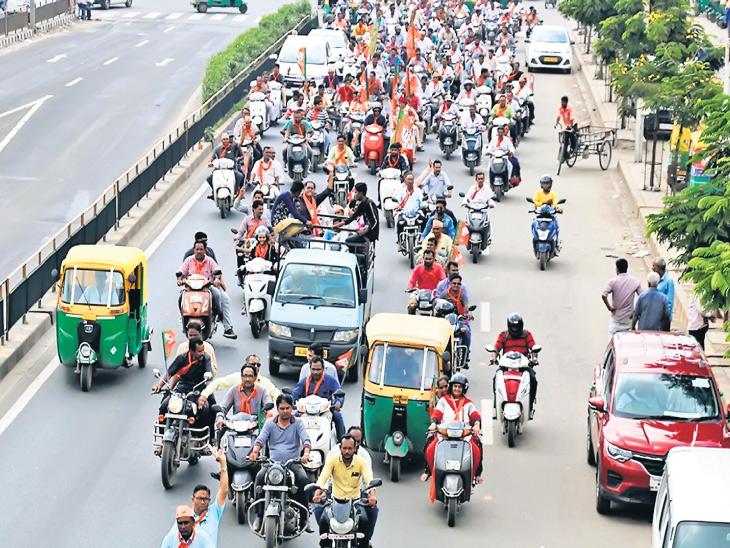 ભાજપના ઉમેદવારની રેલીમાં જોડાનારા કાર્યકરોને હેલ્મેટનો કાયદો ન નડ્યો  - Divya Bhaskar