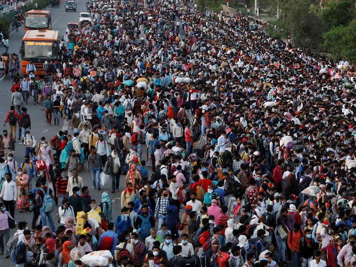 લાખોની સંખ્યામાં મુંબઇથી વતન પરત ફરી રહેલા કામદારોની ફાઇલ તસવીર. - Divya Bhaskar
