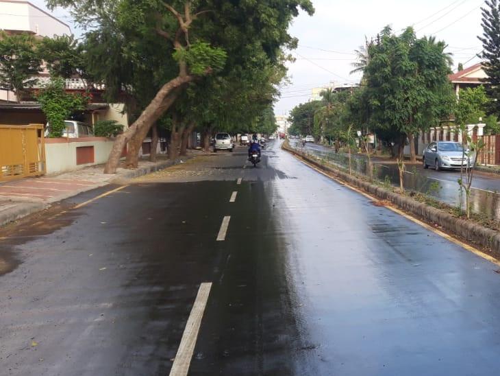 નવસારીમાં વરસાદી છાંટાથી રસ્તાઓ ભીના થઈ ગયા. - Divya Bhaskar