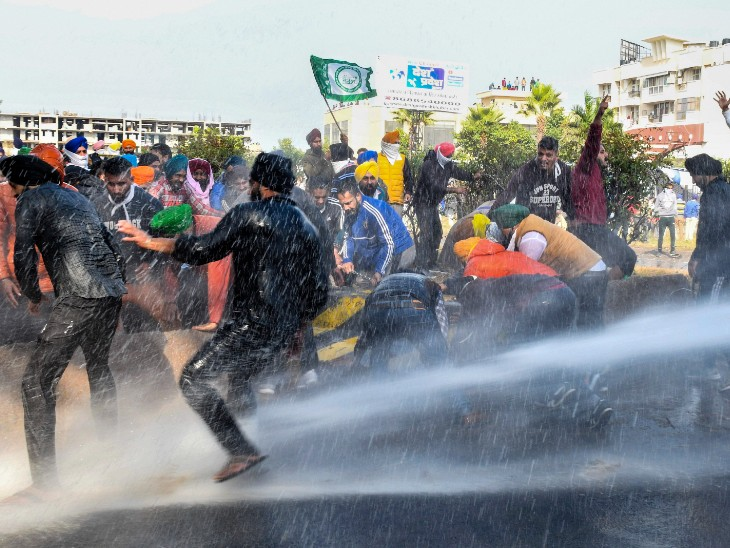 At the Punjab-Haryana border, the police tried to stop the farmers by running water cannons.  The picture is of Ambala.