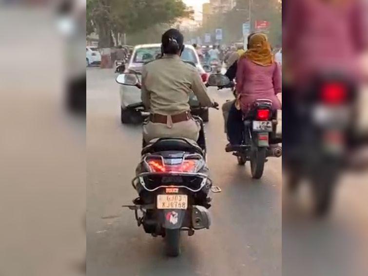 રાજકોટમાં મહિલા પોલીસ કર્મી ચાલુ સ્કૂટરે ફોન પર વાત કરતી દેખાઈ, પોલીસને CCTVમાં ખાખી વર્દી ન દેખાઇ રાજકોટ,Rajkot - Divya Bhaskar