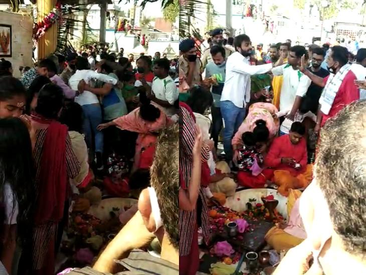 રાજકોટના રામનાથપરા મંદિરમાં તા. ભાજપ યુવા પ્રમુખ અને પુજારી બાખડ્યા, પોલીસ નેતાને ખેંચીને બહાર લઇ ગઇ રાજકોટ,Rajkot - Divya Bhaskar