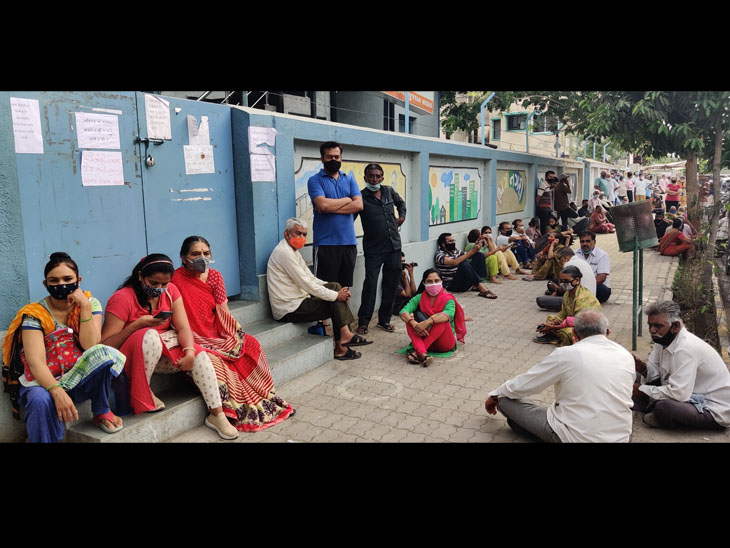 હાલાકી ભોગવનાર રાજકોટવાસીઓની તસવીર - Divya Bhaskar