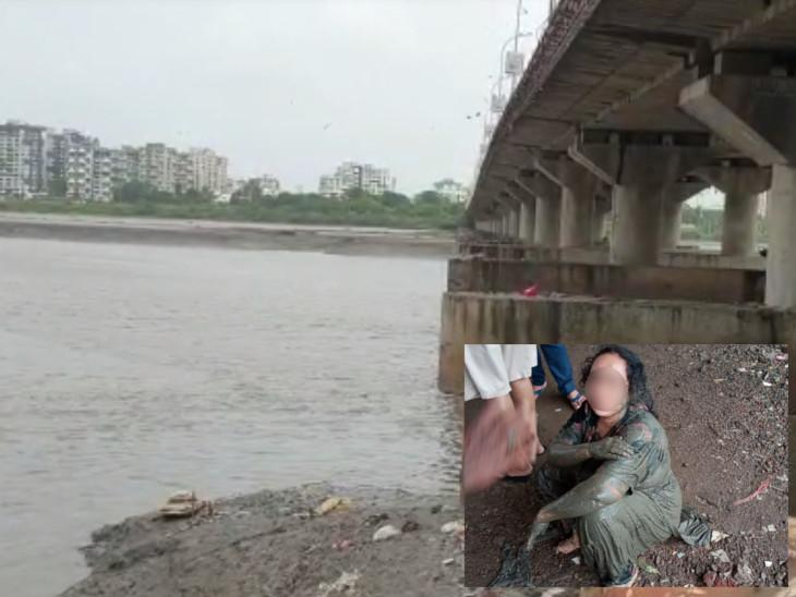સુરતમાં મક્કાઈ પૂલ પરથી કુદીને આપઘાતનો પ્રયાસ કરનાર મહિલા તાપી નદીમાં કીચડમાં ફસાઈ, લોકોએ બહાર કાઢી જીવ બચાવ્યો|સુરત,Surat - Divya Bhaskar